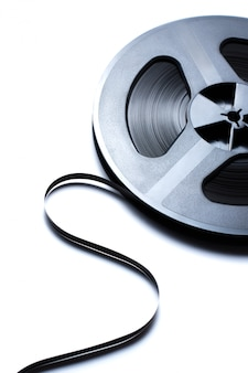 Old reel music tape on white