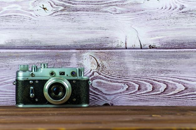 Old retro film camera on beautiful background