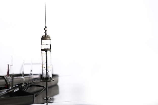 Old retro metal medical syringe and accessories on the table