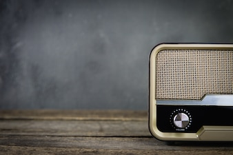 Old retro radio with on table front gray background