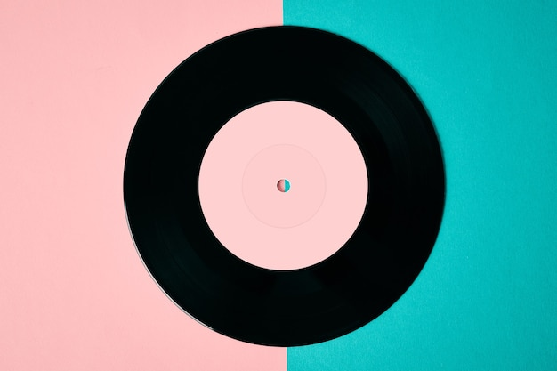 Old retro vinyl disc on colored background