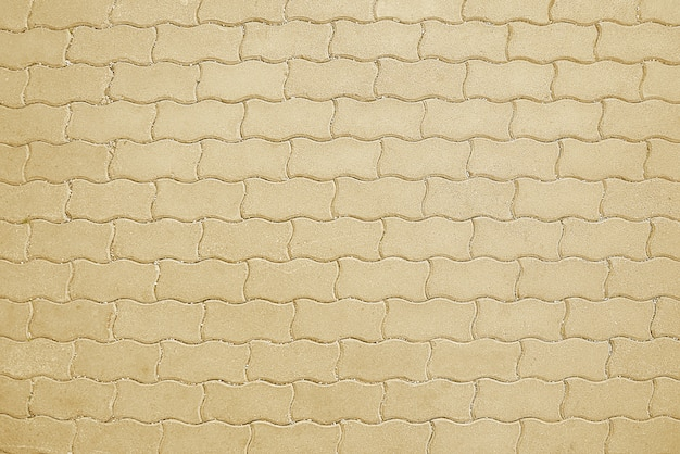 Old road beige mosaic pavement texture