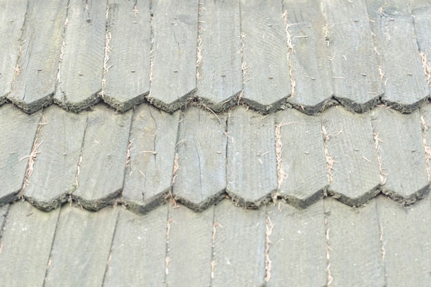 Old roof is made of wooden tiles. texture background.
