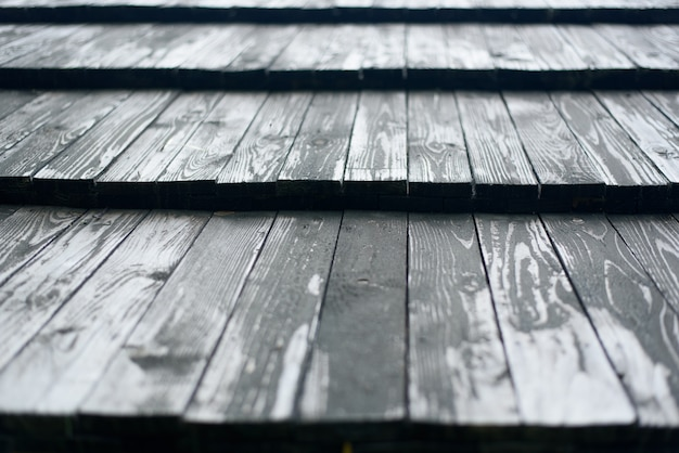 Old roof made of gray wooden planks. close up