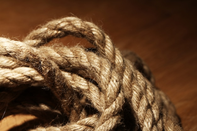 Old rope over wooden surface