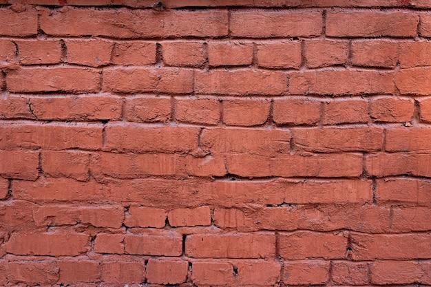 古いラフな赤レンガの壁のテクスチャの背景