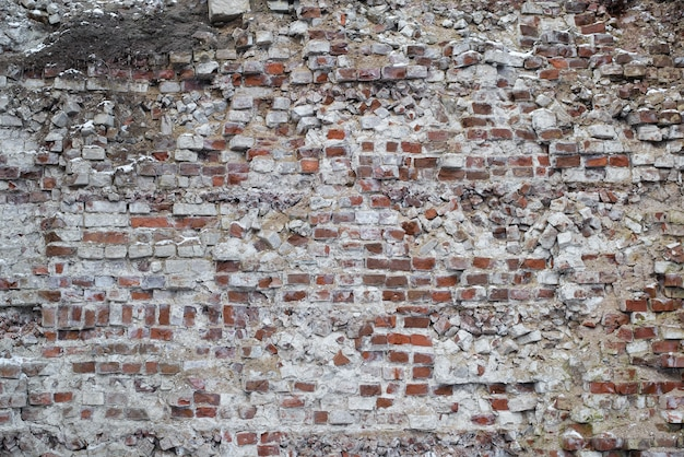 Old ruined red brick wall outside. distant shot. texture background