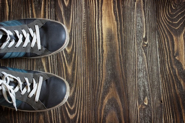 Old running shoes standing on wooden boards