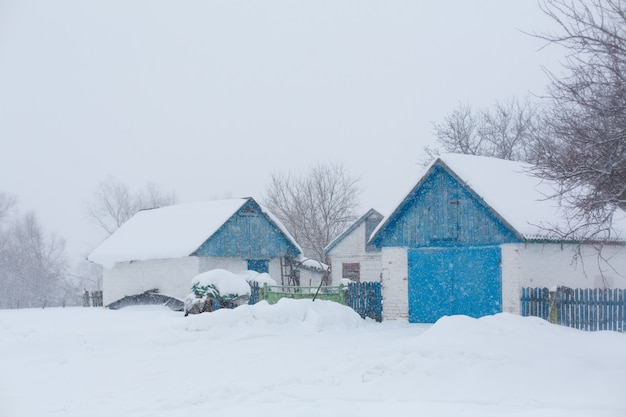 Old rural house. snow blizzard. a lot of snow