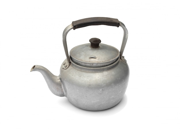 Old rustic aluminum kettle isolated on white