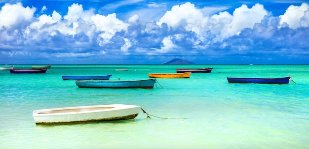 Old rustic fishermen' boats in turquoise sea. mauritius island scenery