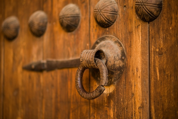 Old rustic vintage wood door closeup background ornamental gate detail texture pattern traditional