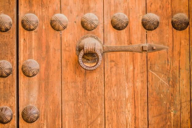 Old rustic vintage wood door closeup background ornamental gate detail texture pattern