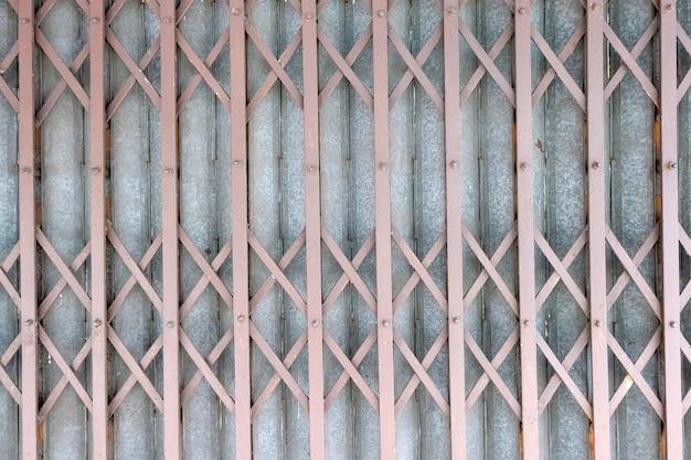 Old rusty antique slide steel door