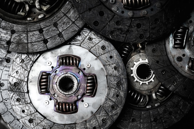Old and rusty car clutch plate disk in second hand machinery shop