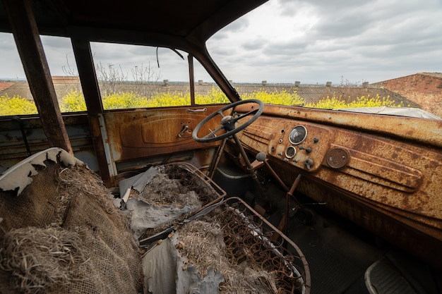 Old and rusty car from inside