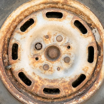 Old rusty car wheel disc.