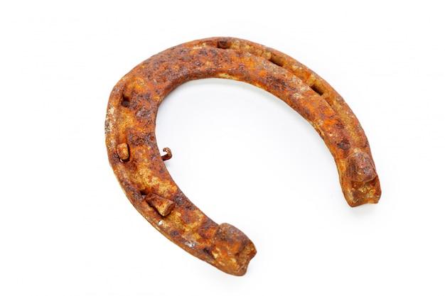 Old rusty horseshoe isolated on white