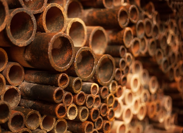 Old rusty pipes decorating wall background design, wallpaper, backdrop.