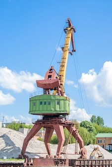 Old rusty port cranes in the industrial zone