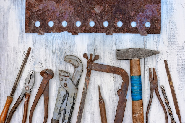 Old rusty tools lie on the workbench