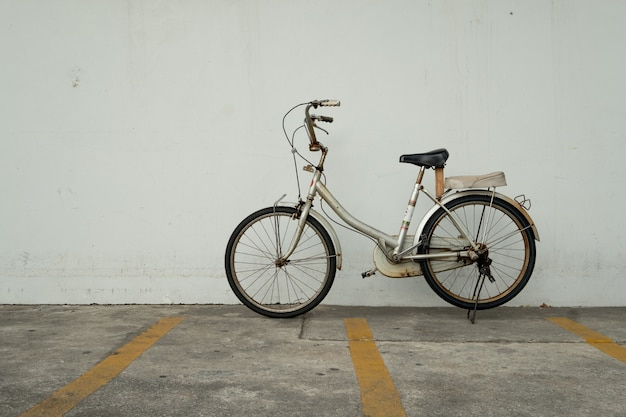Old rusty vintage bicycle at bicycle parking. eco friendly and urban lifestyle concept.