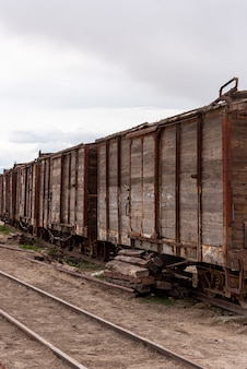 Old and rusty wooden train car abandoned on a railway track. bolivia