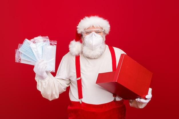 Old santa claus wear protective medical mask remote christmas celebration