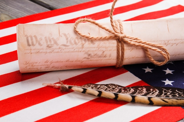 Old scroll with quill ink pen. the usa flag.