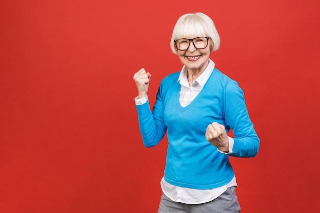 Old senior woman celebrating a success