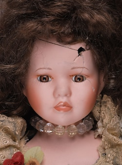 Old severed scary doll head