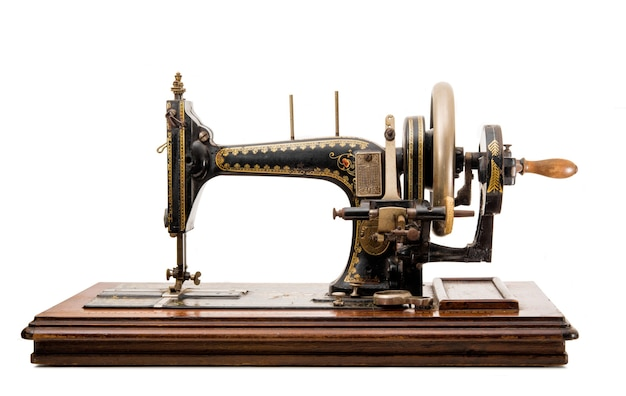 Old sewing machine isolated close up