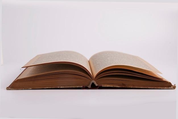 Old shabby books isolated on white background