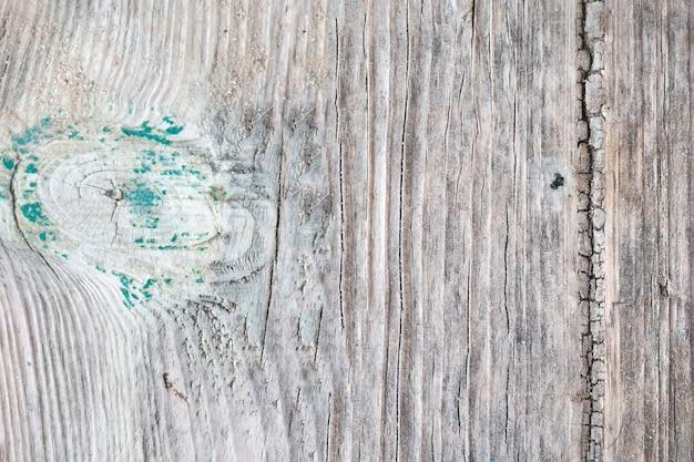 古いぼろぼろのひびの入った木製の背景