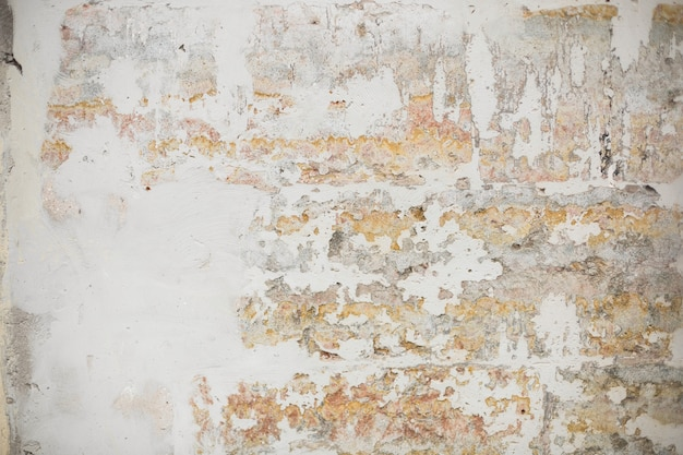 Old shabby wall with crumbling plaster
