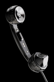 Old shiny headset on black