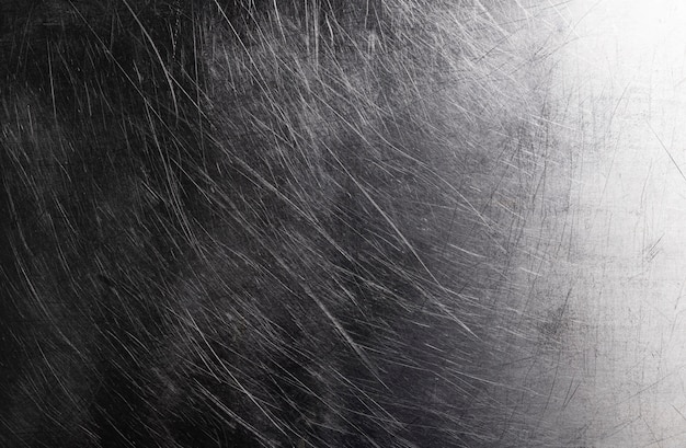 Old shiny metal background, dark brushed metal texture with scratches
