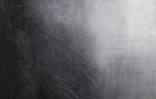 Old shiny metal background, dark polish metal texture with scratches and light gradient