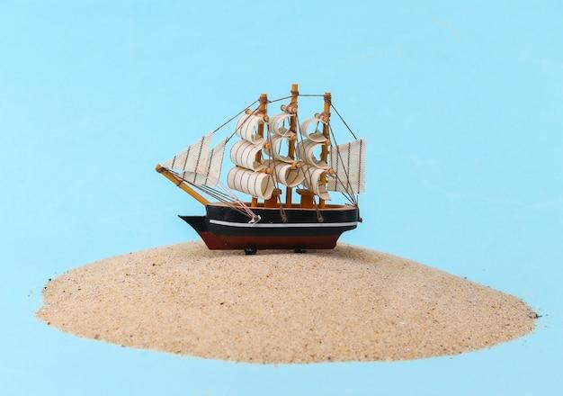 Old ship on sand island.