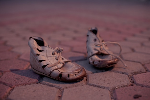Old shoes for poor child