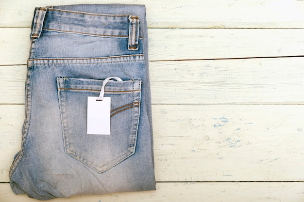 Old short denim on rustic white wooden table