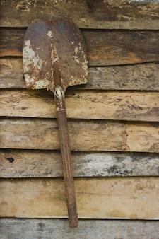 Old shovel on wood