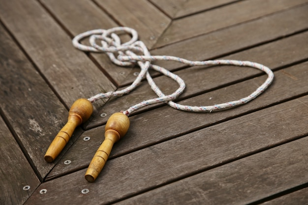 An old skipping rope on a wooden deck. exercising