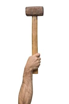 男の手に古いハンマー