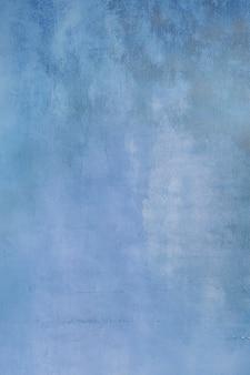 古い滑らかな青いステンドグラスの背景