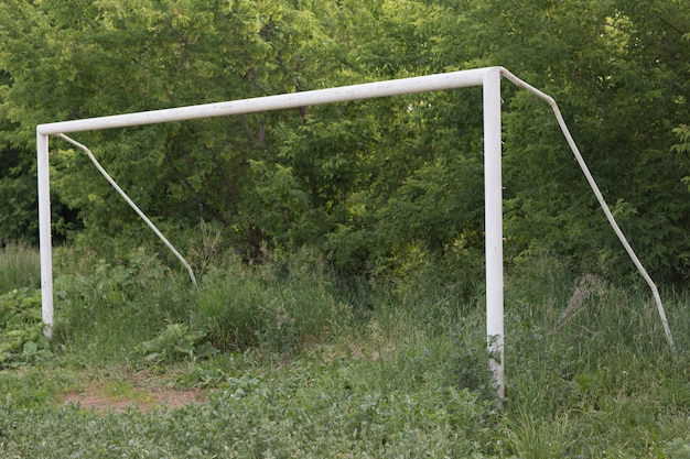 Old soccer football gate on field with green grass