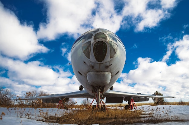 Old soviet aircraft on the conservation against the background of clouds.