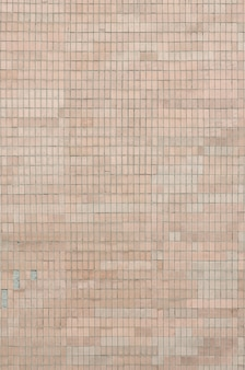 Old soviet beige wall tiles. the texture of the classical outer tile
