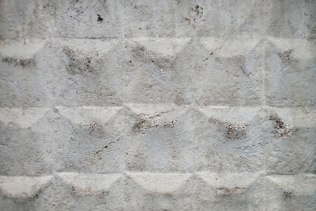 Old soviet concrete fencing with cracked surface close-up. background image of grunge fence of unusual design. urban white durable wall.