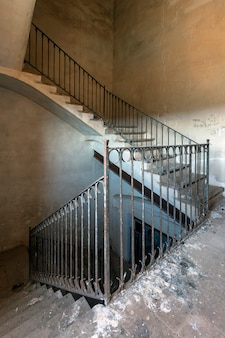 Old staircase with metal railing